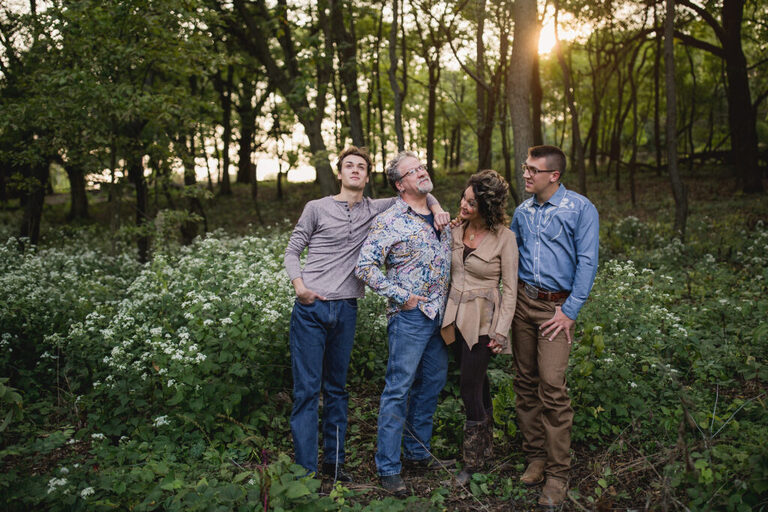 Family gazing at each other in a forest preserve photoshoot